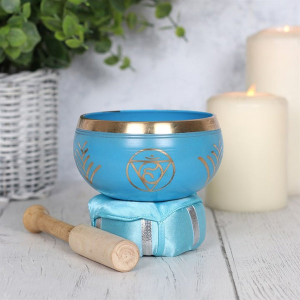 Traditional Tibetan style singing bowl made from brass. The bowl is turquoise and gold in colour and handfinished with the Vishuddha throat chakra symbol. Wooden mallet and cushion included.