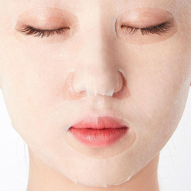 she sheet mask on face