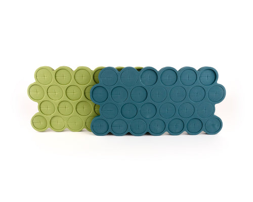 26 bright-green foam stem collars in mold, on top of 26 teal foam stem collars in mold.