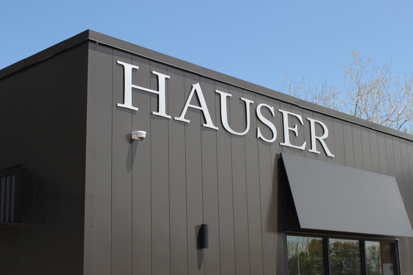 Outside of Hauser Storefront showing Hauser sign