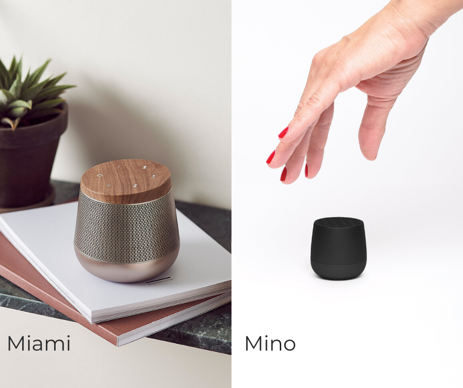 one palm sized black speak and one larger bronze speaker with woodgrain top.