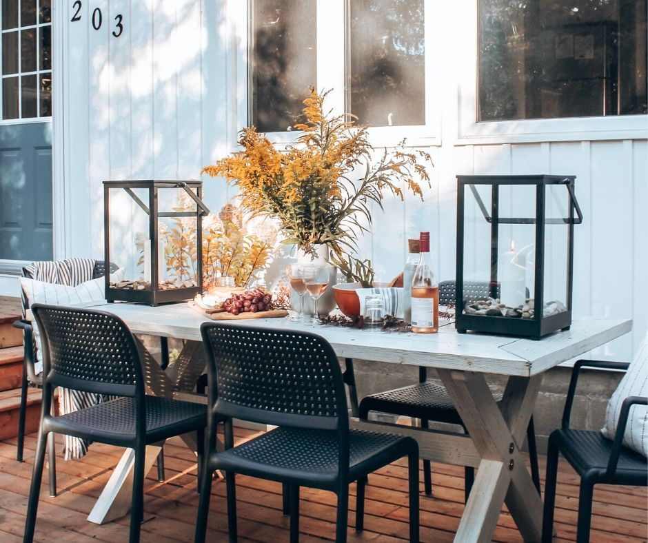 Modern  square black cabot lanterns on an outdoor patio in fall