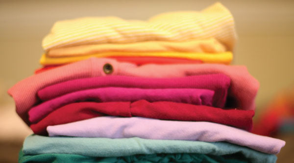 Folded clothing Photo Courtesy of @AGKrejci Pixabay