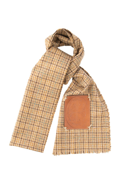 Tartan scarf with leather brand application
