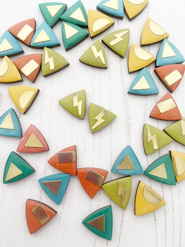 Hand painted triangle studs made from birch plywood.
