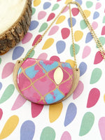 Colourful Moroccan style handmade necklace in shades of bright pink & blue with shimmery gold