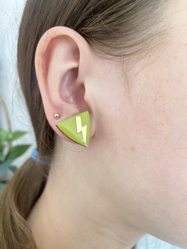 Hand painted olive green triangle studs made from birch plywood.