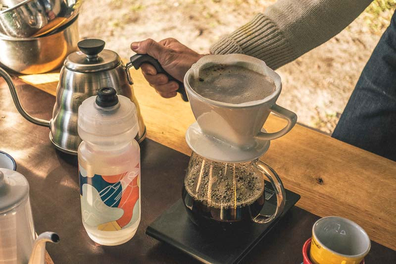 brewing coffee camping with drink bottle