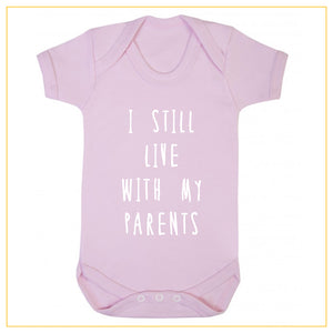 I still live with my parents baby onesie in dust pink