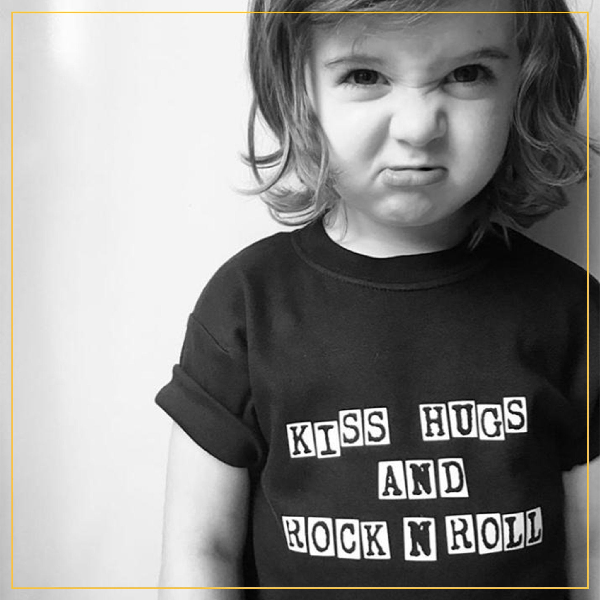 boy in a kiss hugs and rock n roll t-shirt