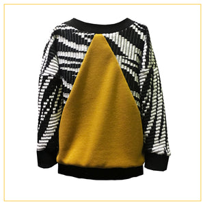 black and white jumper with yellow triangle cutout