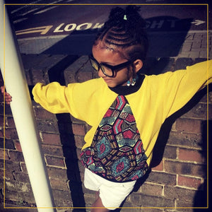 bespoke yellow sweatshirt with multicoloured triangle cutout