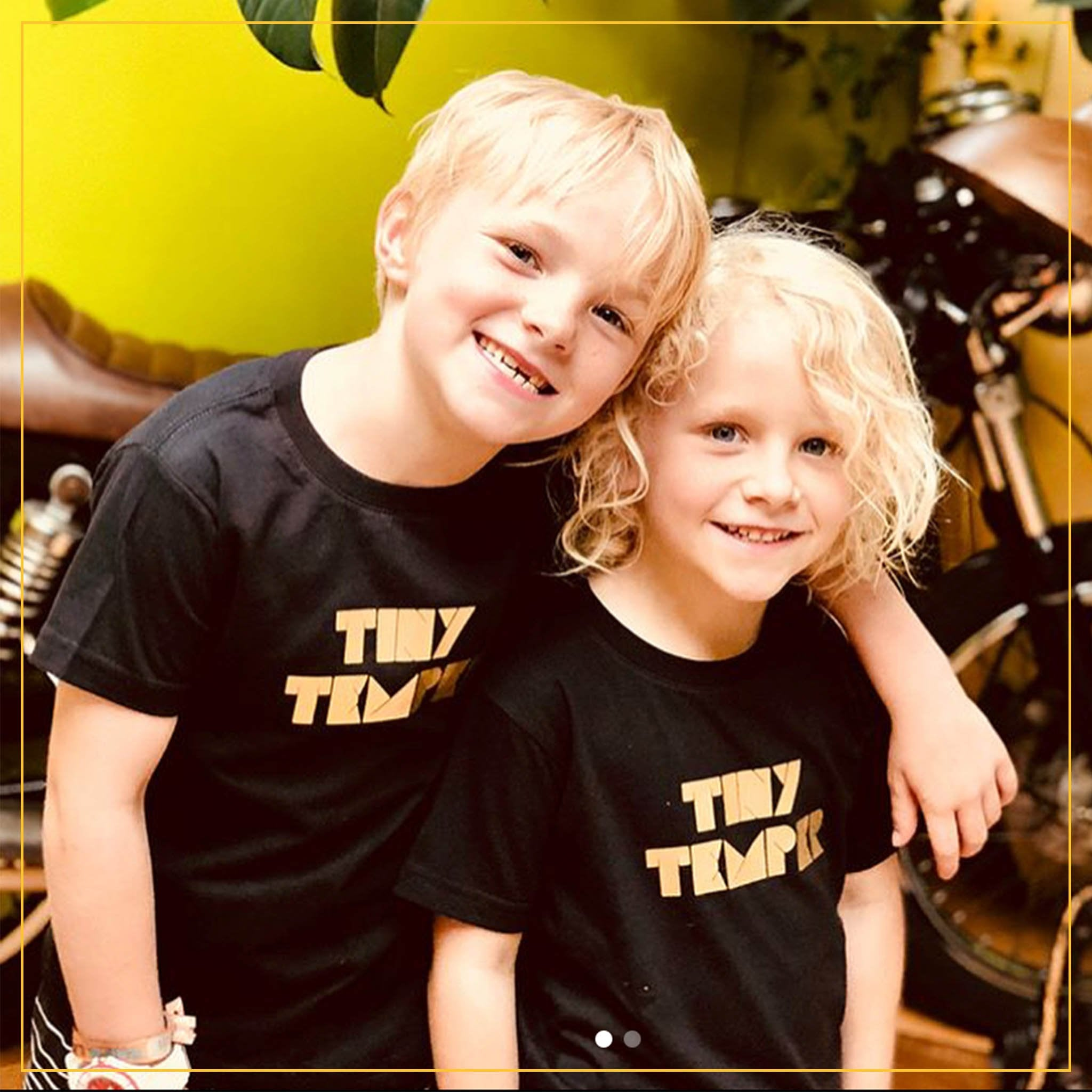 boy and girl in black novelty tees with 'tiny temper' print