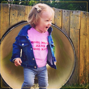girl in a cool mums have cool kids baby pink t-shirt