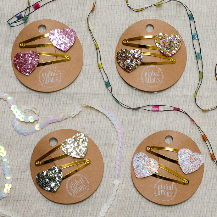 global affairs glitter heart clips
