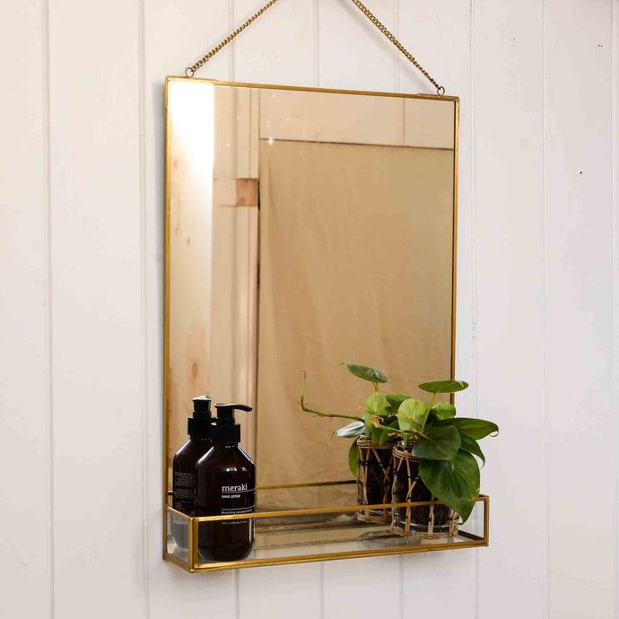 brass framed gold mirror with shelf