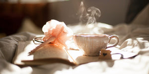 Image of a hot tea cup on a book