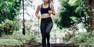 Image of woman running/sweating