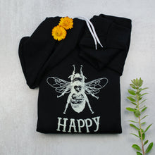 Load image into Gallery viewer, Bee happy black zip up hoodie in black with props