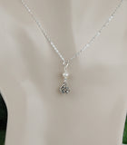 GS669 White Freshwater Pearl with Round Celtic Knot