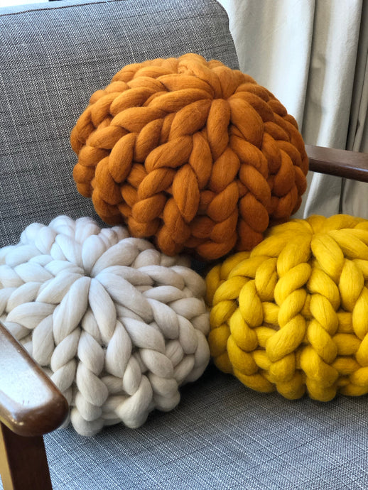 Round chunky knit merino cushion