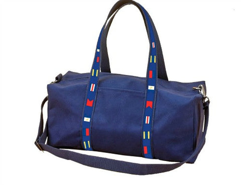 Navy canvas weekender bag with signal flag ribbon detail