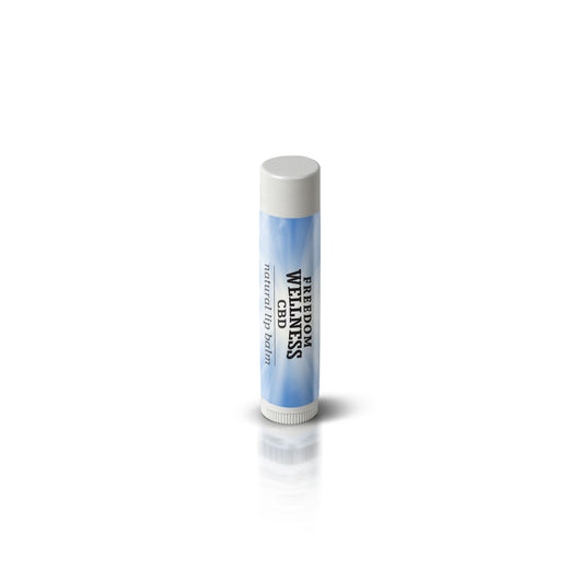 Top angle view of a tube of Freedom Wellness CBD infused lip balm. Small white plastic tube with a white lid and blue Freedom Wellness Label.