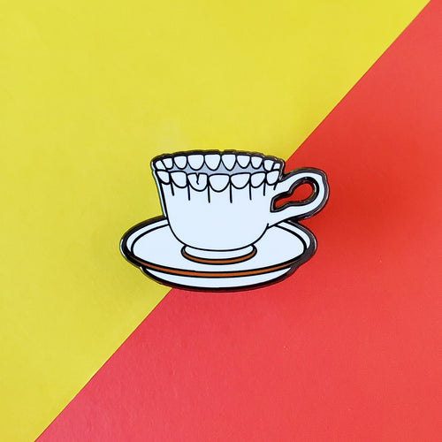 Biting Teacup Enamel Pin