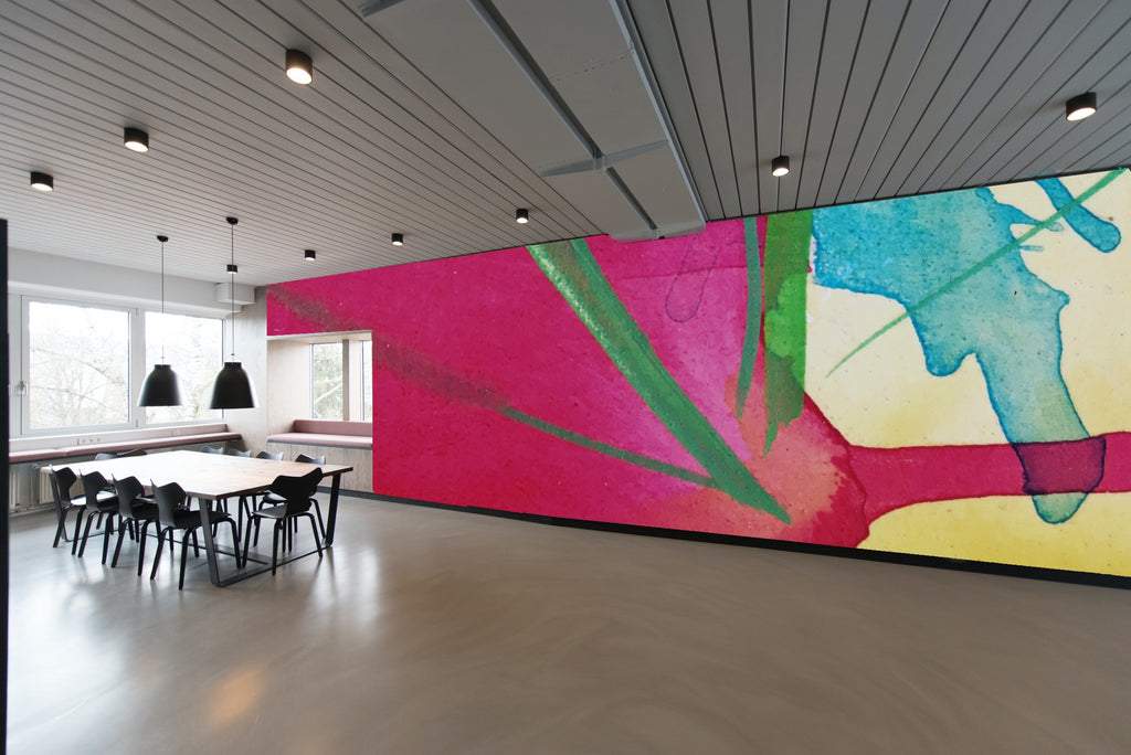 Modern office space with colorful wall art in background.