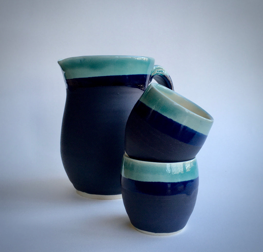 Ceramic cups and pitcher