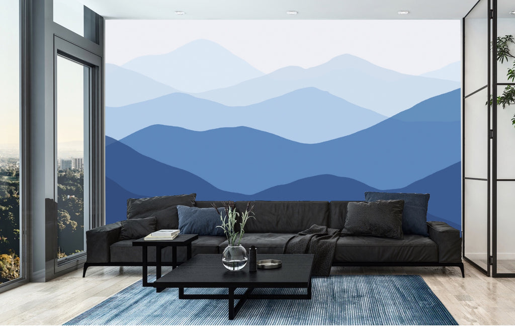 Modern living room with mural of blue mountains
