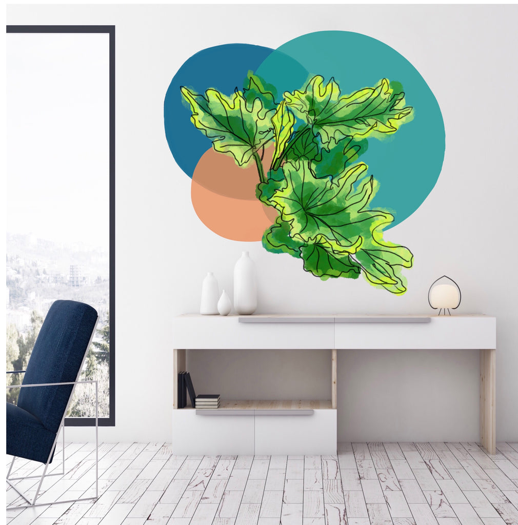 A mural with colored circles and philodendron leaves painted above a desk