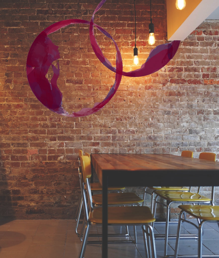 Brick wall with purple wine rings painted as a mural