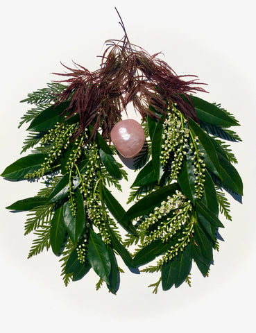 Cherry laurel leaves and blossoms form lungs around a rose quartz heart