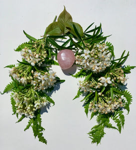 Mock Orange flowers form lungs surrounding a rose quartz heart