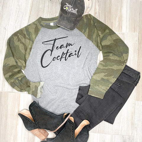 Camo sweatshirt paired with heels and black jeans