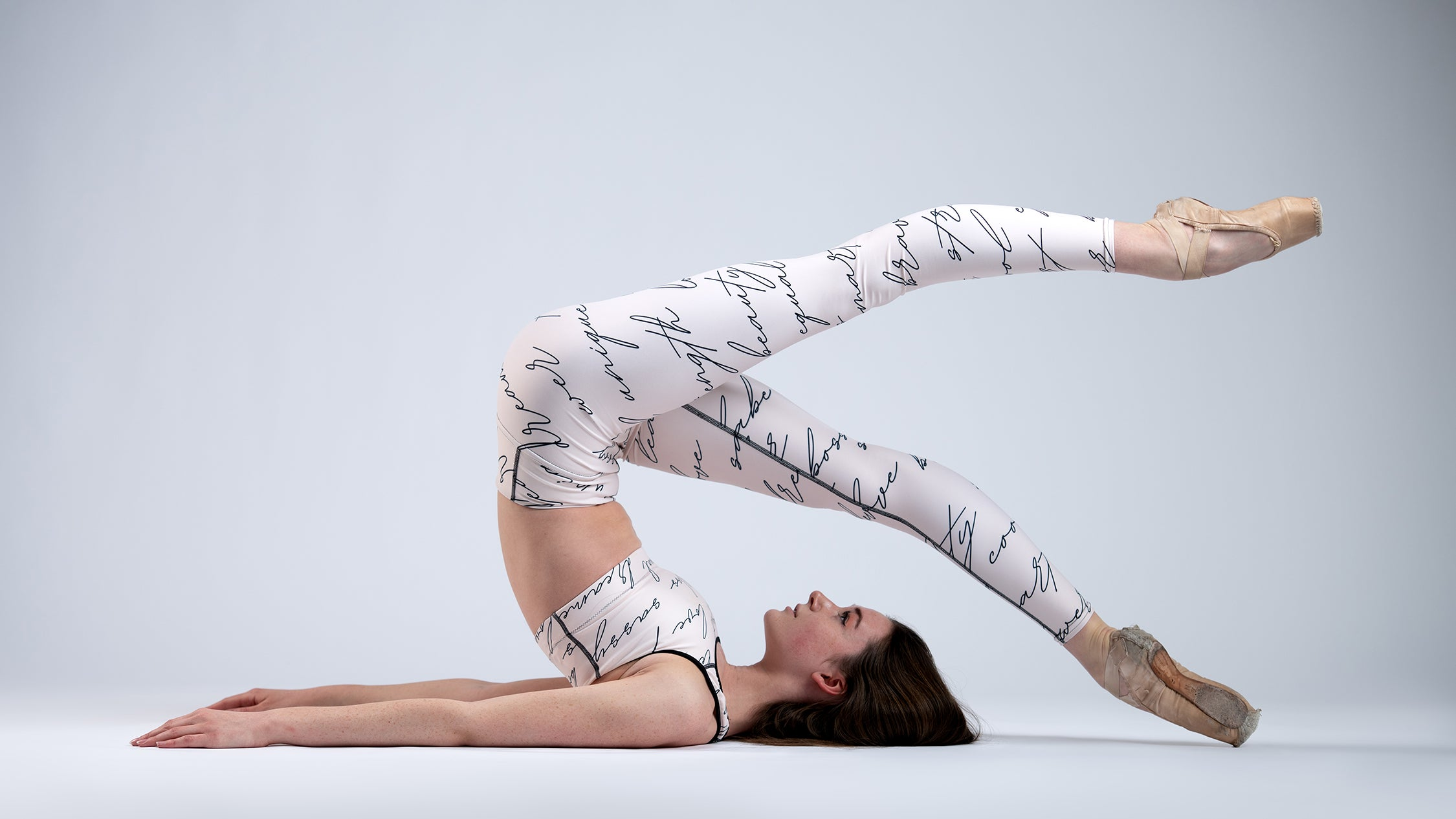 The Cool Ppl activewear on a ballerina with powerful words for women supporting women.