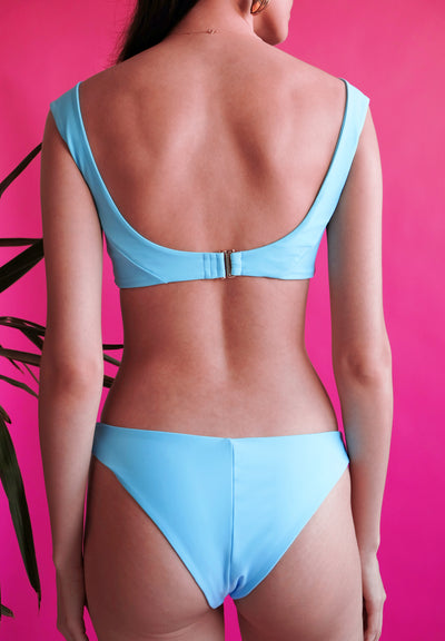 Women's blue bikini back view sustainable swimwear by The Nudist