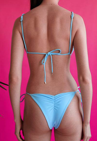 Women's blue string bikini back view eco-friendly swimsuits by The Nudist