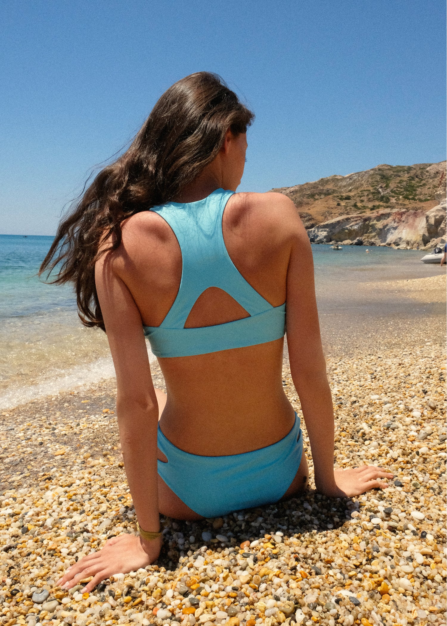 Women's blue sport 2-piece bikini top back view recycled nylon by The Nudist