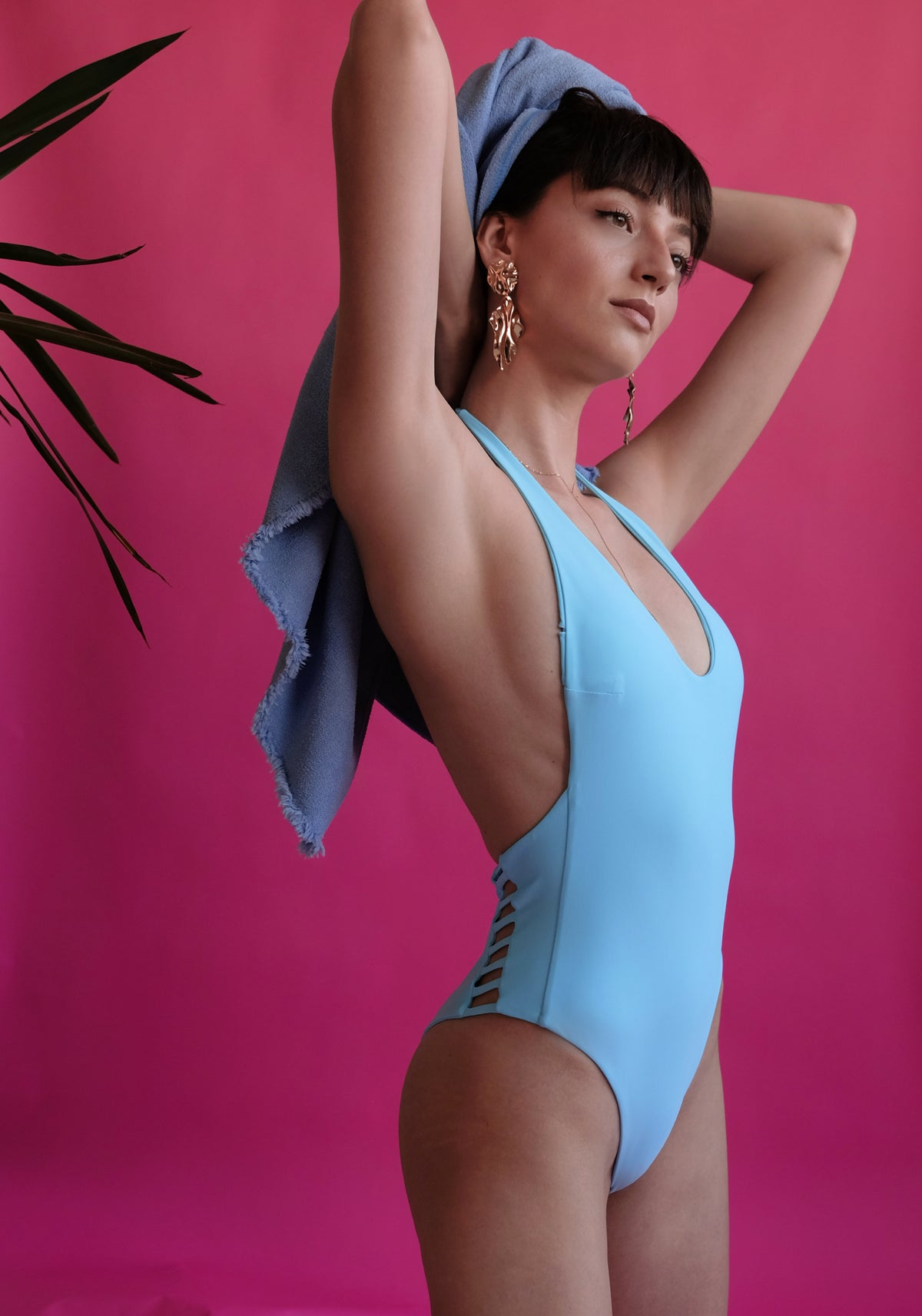 Women's blue one-piece side view eco-friendly swimwear by The Nudist