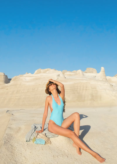 Women's blue one-piece at the beach eco-friendly swimwear by The Nudist