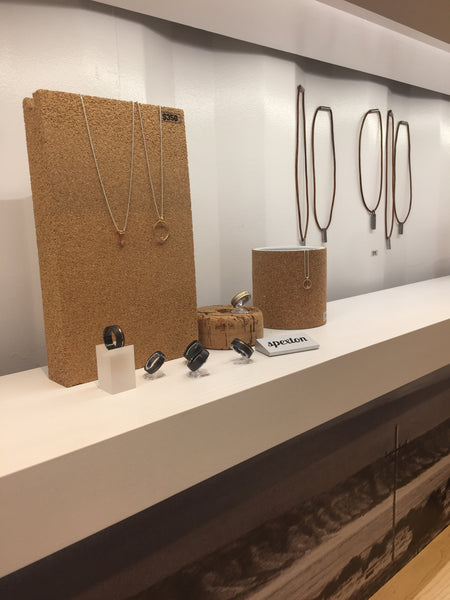 Necklaces and rings on display inside Spexton Boxyard, a downtown Tulsa Jewelry Store known for custom made wedding rings
