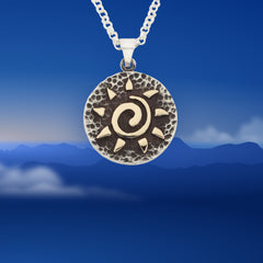 mountain sun disk necklace sterling silver with 10K yellow gold spiral sun