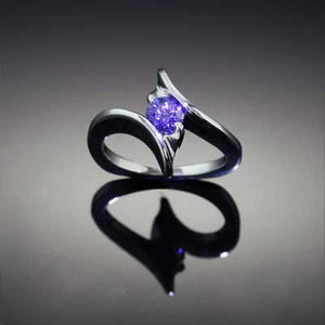 Tanzanite Twist ring 14K WG