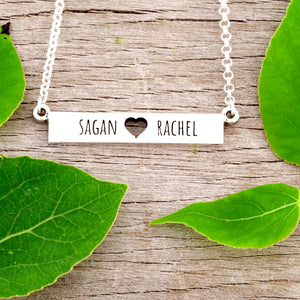 Love necklace with cutout heart and couple names