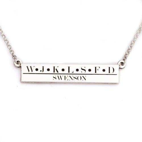 family bar necklace with family name and initials of family members