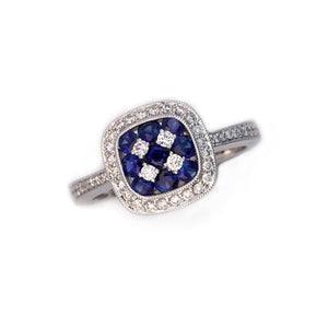 Blue sapphire and diamond ring in 18K white gold