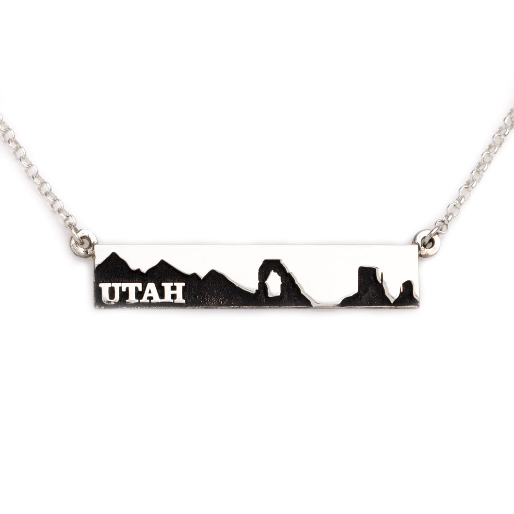 utah bar necklace with utah mountains and arch and monument valley