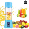"Blue Portable USB blender with an orange splash on the side and fruit inside of the blender. In the background is fruit and cups of juice with a logo that says ""Silicone Kitchen"""